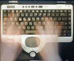A photo of hands over an old Compaq keyboard, like a ghostwriter.