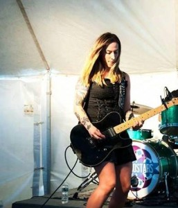 Lindsay Manfredi plays bass. She's one of the true rock stars in music AND personal branding.
