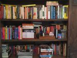 My bookshelf at home. I've whittled my books down to favorite authors and books by friends.