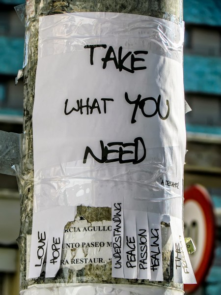 Take what you need sign taped to a telephone pole