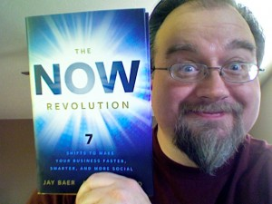 Erik Deckers holding a copy of The NOW Revolution