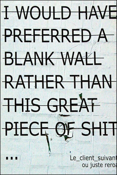 Sign that says I Would Have Preferred a Blank Wall Rather Than This Great Piece of Shit. This applies to most marketing messages, especially the ones that say In these troubled times.