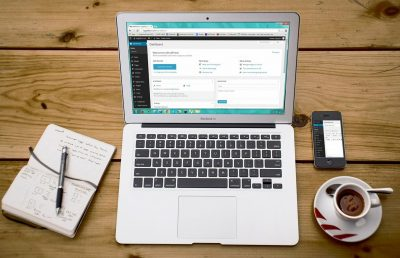 Photo of a laptop showing WordPress. We regularly use WordPress as part of our business blogging services
