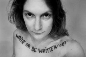"Nude woman with the words ""write or be written off"" written across her front shoulders"